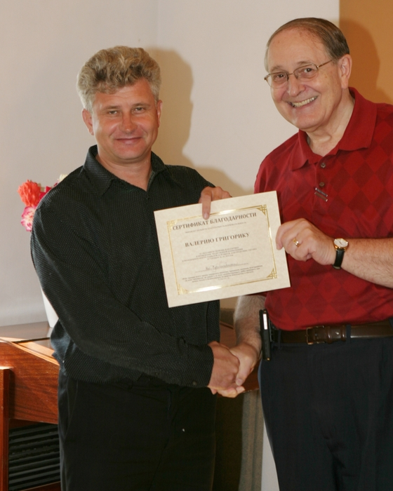 Receiving a certificate after a Prayer Conference