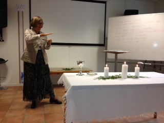 "Pastor Karol signing the words of the song, ""Table of Grace"""